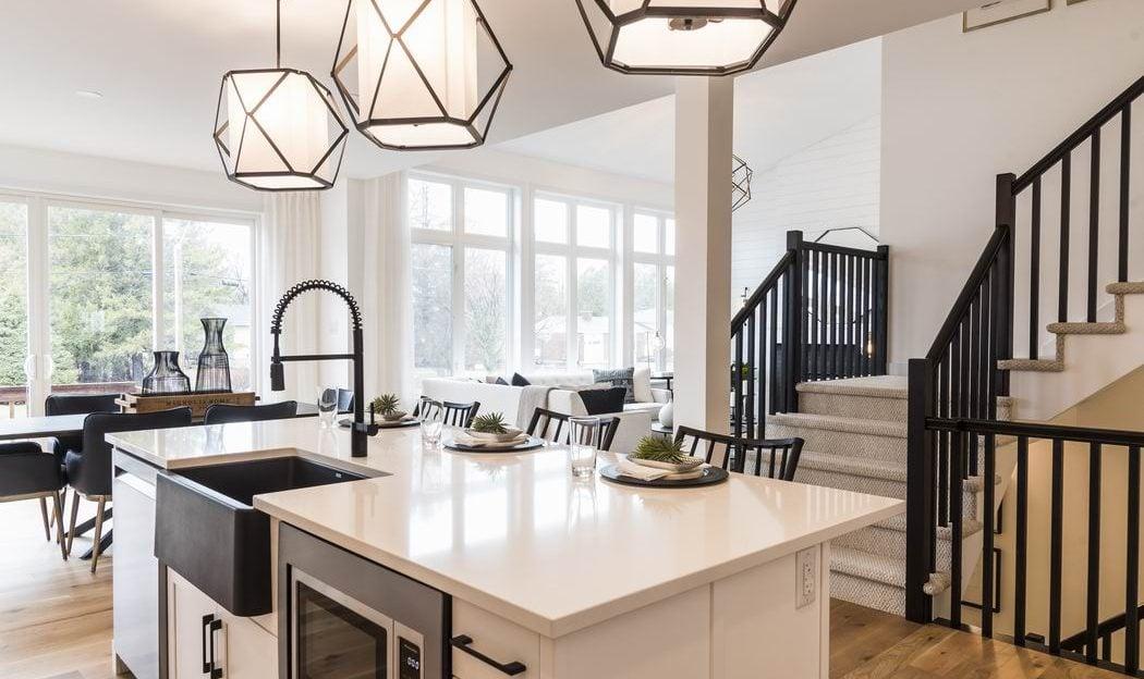 Nichols model home Cardel Homes Creekside Richmond kitchen island apron sink pendant lights open concept