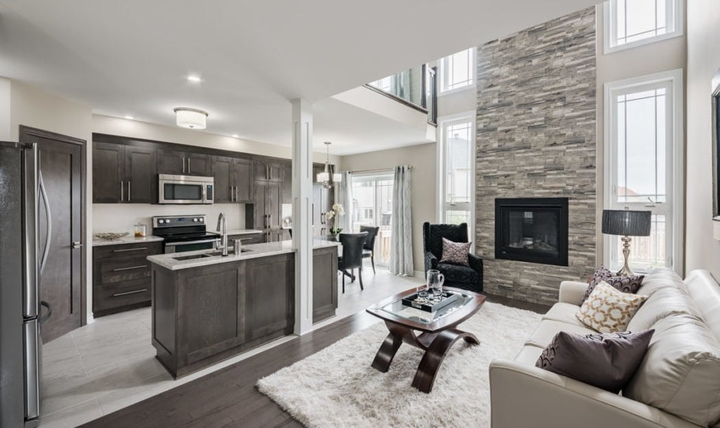 Cozy wood tone and glass main living area of the terressa bassett townhome