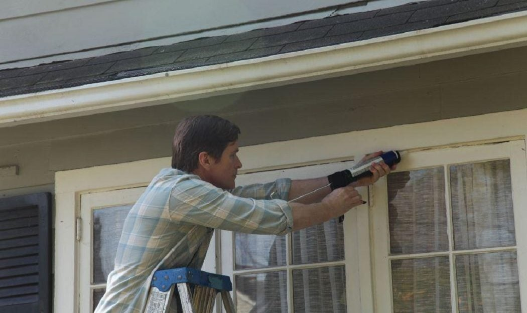 Homeowner Helpers caulking windows and doors