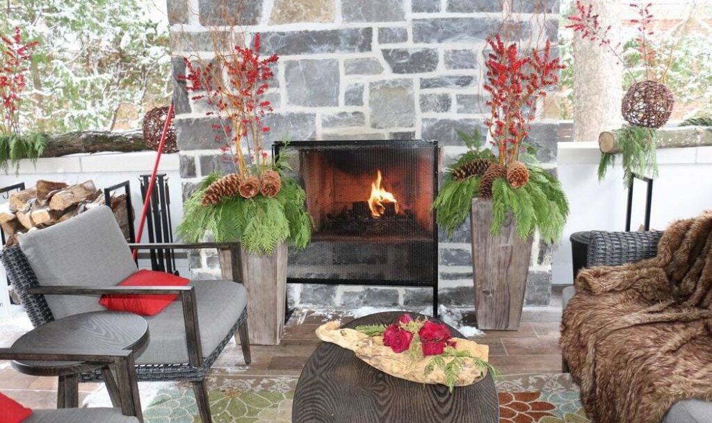 Homes for the Holidays Mill Street Florist Christmas decorating outdoor fireplace outdoor room