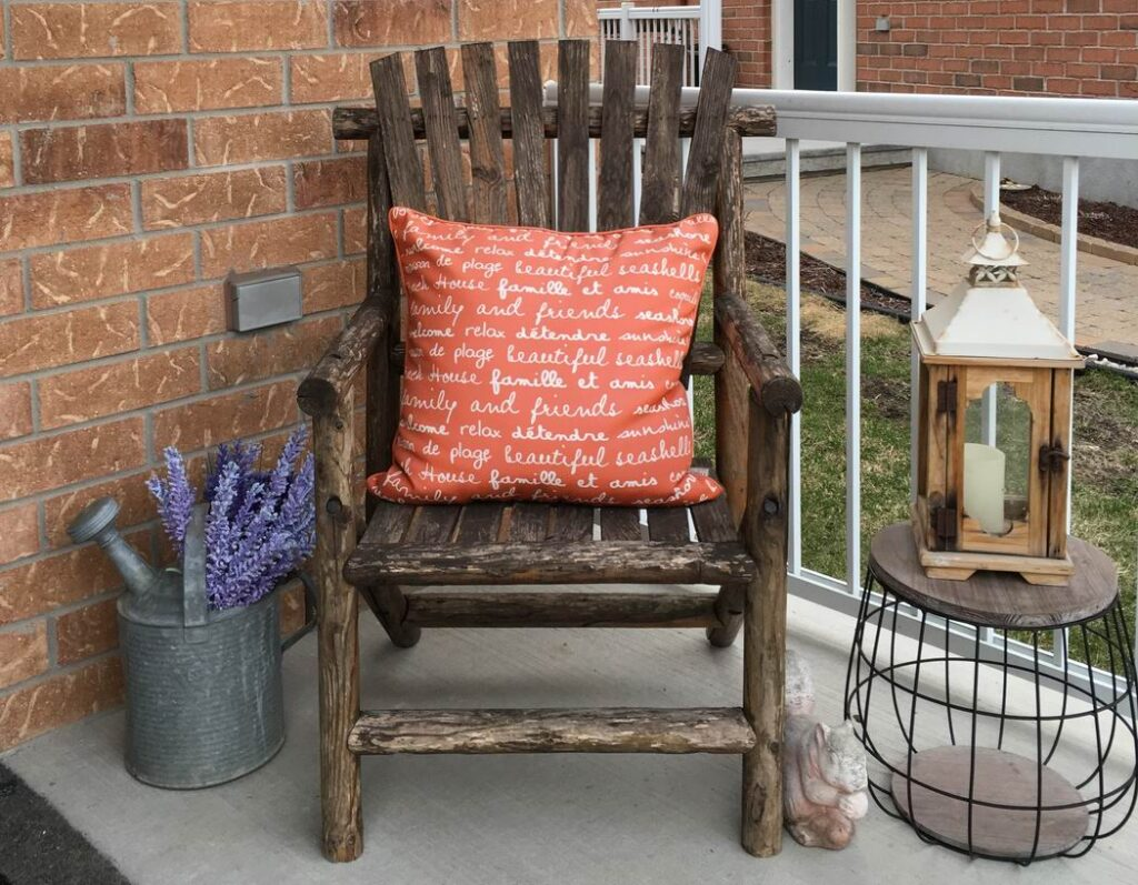 how to create outdoor spaces front porch rocking chair watering can hurricane lamp Sue Pitchforth