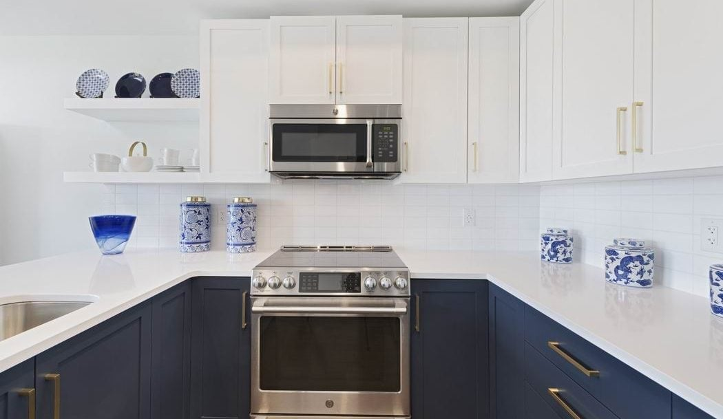 cleaning your range hood filter over the range microwave two-tone kitchen