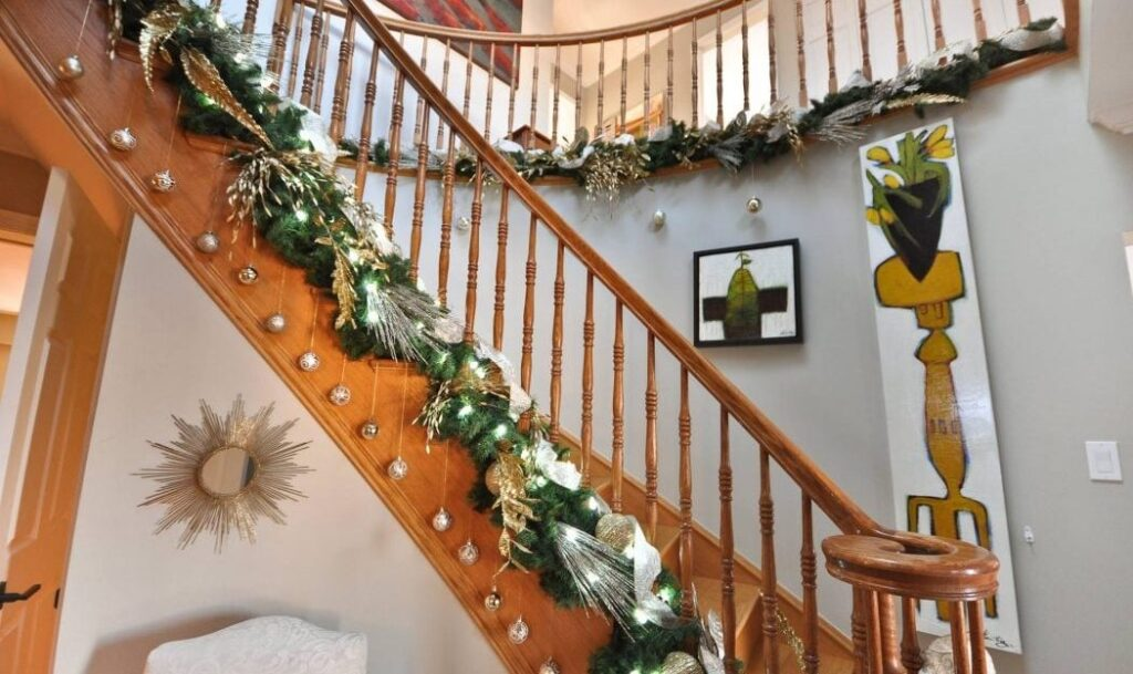 Homes for the Holidays Trillium Floral Designs Christmas decorating banister garland